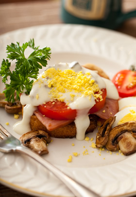 Mock up Eggs Benedict with tomatoes, mushrooms and parsley